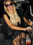 Paris Hilton flashes pussy upskirt again