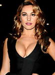 Kelly Brook busts out her great cleavage