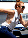 Miley Cyrus perky breasts pop out of top